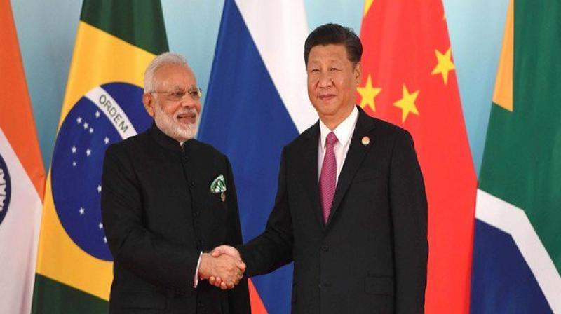 The summit is being seen as an effort by India and China to rebuild trust and improve ties that were hit by the 73-day-long Doklam standoff last year. (Photo: ANI/Twitter)