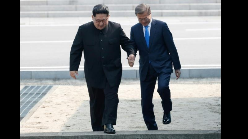 Kim Jong Un and Moon Jae-in were engaged in a metaphorical and literal diplomatic dance on Friday when they met at the frontier. (Photo: AFP)