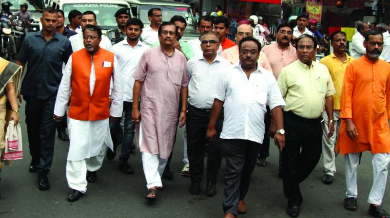 BJP leaders Mukul Roy, Jayprakash Mazumder along with others in a ABVP rally demanding CBI enquiry into Islampur student killings at Esplanade, Kolkata, on Tuesday. (Photo: Abhijit Mukherjee)