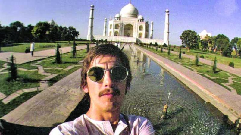 George Harrison in a selfie with the Taj Mahal