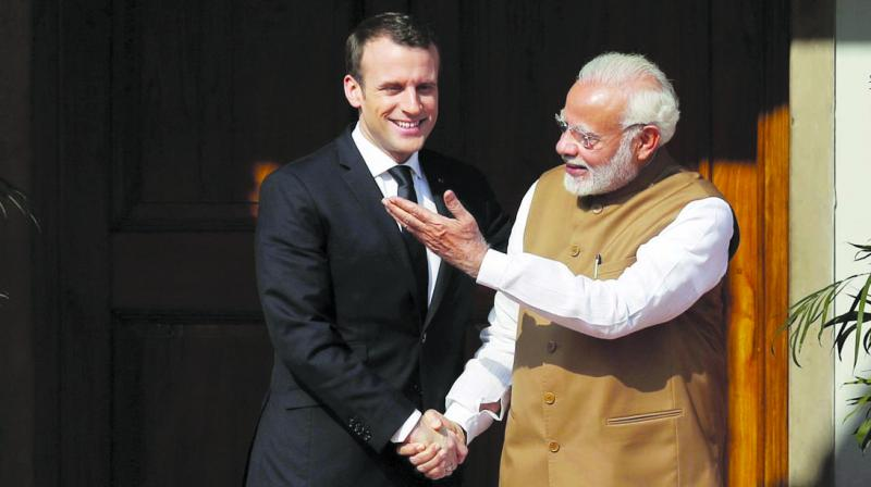 Prime Minister Narendra Modi welcomes French President Emmanuel Macron at the International Solar Alliance founding conference in New Delhi. (Photo: AP/File)