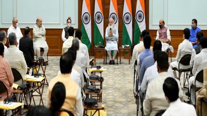 Visual from PM Narendra Modi's meet at Lok Kalyan Marg ahead of cabinet expansion. (ANI Photo)