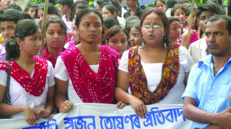 Students and job aspirants protesting against the job scam in Guwahati