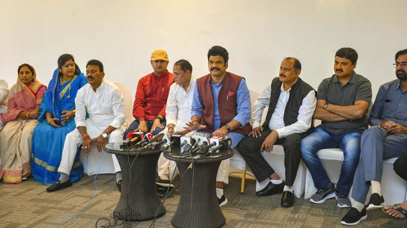 Rebel Congress MLAs from Madhya Pradesh address a press conference at a resort in Bengaluru on March 17, 2020. (PTI)