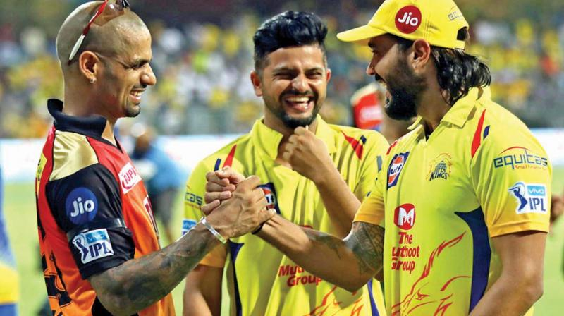 Shikhar Dhawan (left), Suresh Raina (centre) and Murali Vijay.