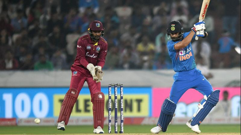 While the batting led by Virat Kohli put up a good show, the bowlers found themselves at the receiving end of some power-hitting by Evin Lewis, Shimron Hetmyer and captain Kieron Pollard. (Photo: AFP)
