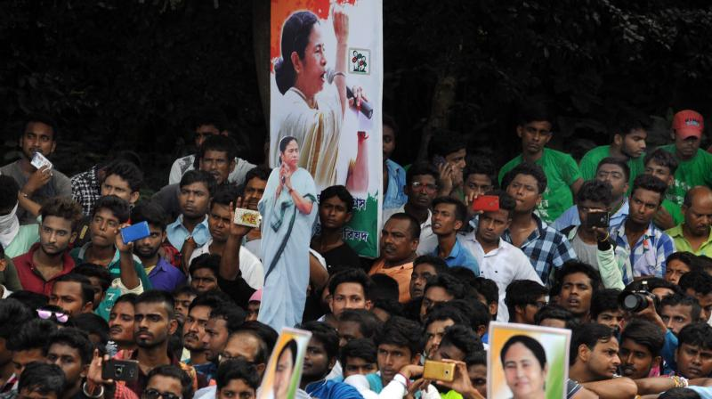 People listen to chief minister Mamata Banerjee (not in the photo) addressing the TMC Chhatra Parisad foundation day rally at Mayo Road in Kolkata on Tuesday.  (Photo: Abhijit Mukherjee)