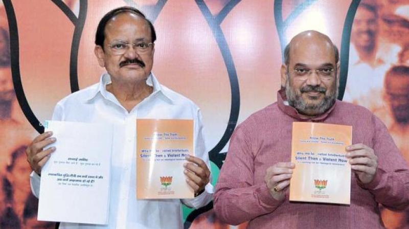 Union Minister Venkaiah Naidu and BJP chief Amit Shah (Photo: File/PTI)