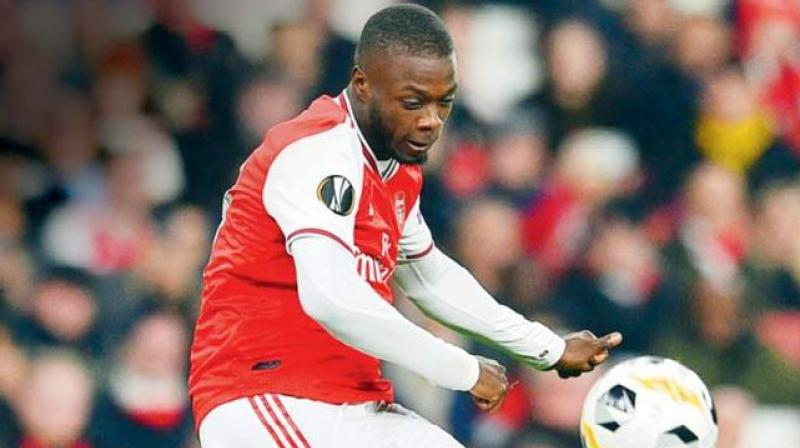 Arsenal's interim coach Freddie Ljungberg says he will have a chat with Nicolas Pepe to help the Ivorian forward feel more settled after his club record move from Lille. ( Photo: AFP)