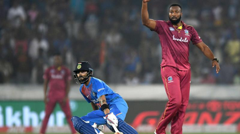 After facing a six-wicket defeat at the hands of India in the first T20I, West Indies skipper Kieron Pollard said that bowlers bowled too many extra deliveries which benefited the hosts (Photo:AFP)