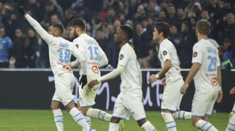 Marseille kept pace with Ligue 1 leaders Paris Saint-Germain on Sunday after coming from behind to beat Bordeaux 3-1 ( Photo:AP)