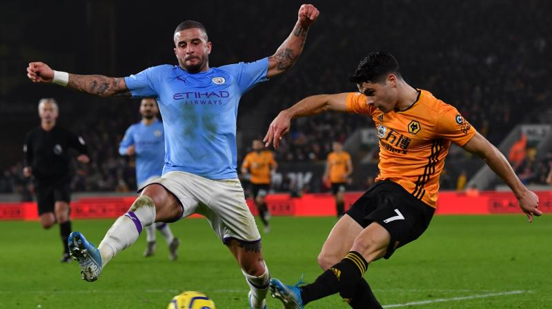 Pep Guardiola admitted Manchester City's faint hopes of retaining the Premier League title were in tatters as they blew a two-goal lead and had Ederson sent in a dramatic 3-2 defeat at Wolves on Friday. (Photo:AFP)