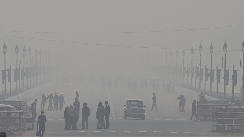 A view of the Rajpath during a cold and foggy winter morning, in New Delhi, Tuesday, Jan. 12, 2021. (PTI)