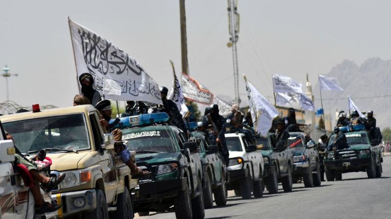 Taliban fighters atop vehicles with Taliban flags parade along a road to celebrate after the US pulled all its troops out of Afghanistan, in Kandahar on September 1, 2021 following the Taliban's military takeover of the country. (Photo: AFP)
