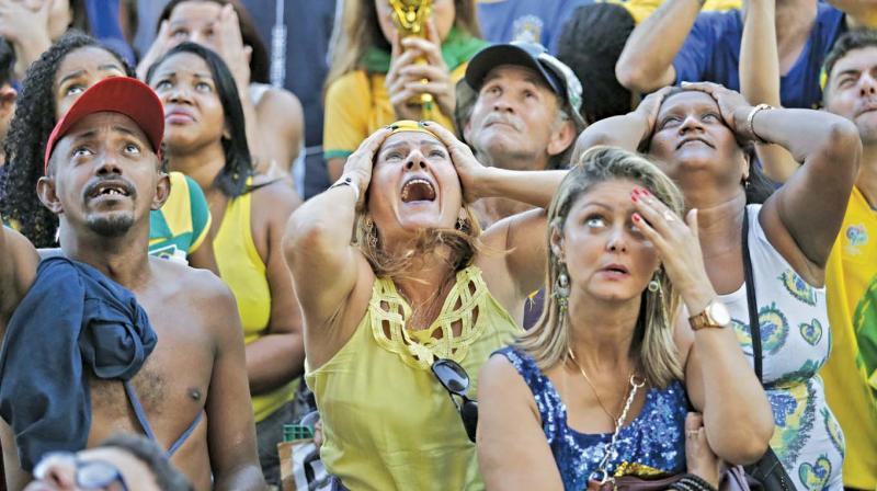 Brazil fans look crestfallen. (Photo: AP)