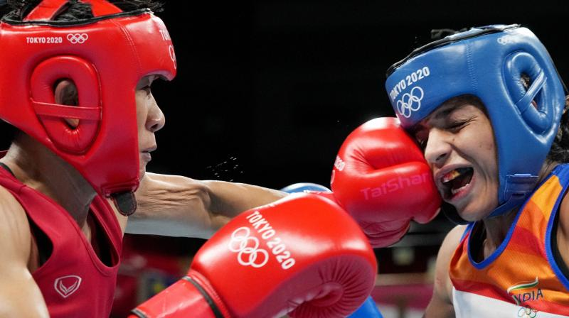 Sudaporn Seesondee of Thailand lands a punch on India's Simranjit Kaur during their bout in in the Women's Light (57-60kg) round of 16 boxing match, at the Summer Olympics 2020 in Tokyo. (Photo: PTI)