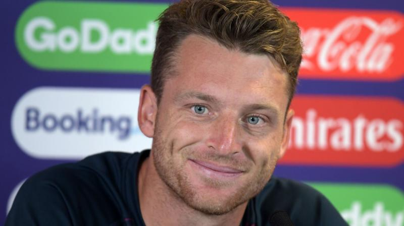 Since his century against Pakistan a month ago, Buttler's batting has gone off the boil but the wicketkeeper contributed to England's win over New Zealand with a brilliant diving catch to dismiss Martin Guptill. (Photo: AFP)