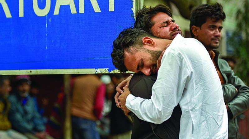 Relatives of Mohsin Ali, who died in communal violence in Northeast Delhi, cry after receiving his dead body outside the mortuary of GTB Hospital in New Delhi on Thursday. The death toll in the Delhi communal violence has reached 38. (Photo:  PTI)