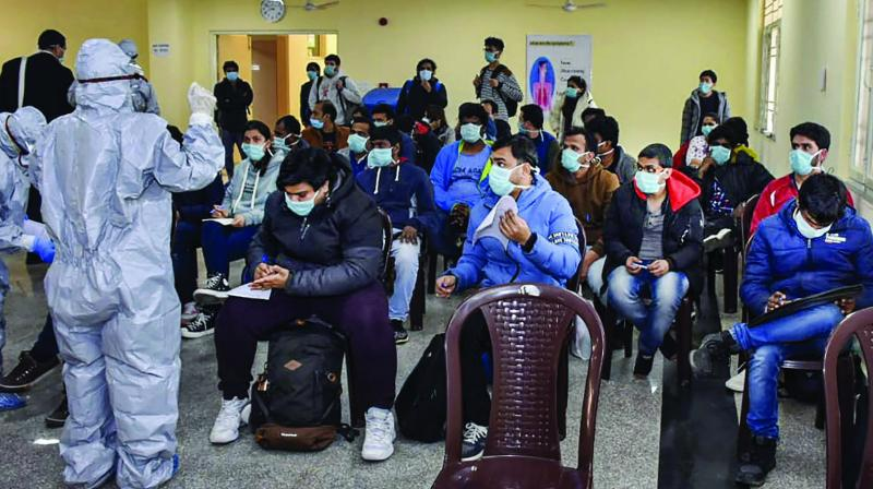 In this handout photo provided by ITBP, 112 evacuees including 36 foreign nationals who were airlifted from Wuhan, China, following out-break of the deadly novel coronavirus, being quarantined by the ITBP Quarantine Facility, at Chhawla Camp in New Delhi on Thursday. (Photo: PTI)