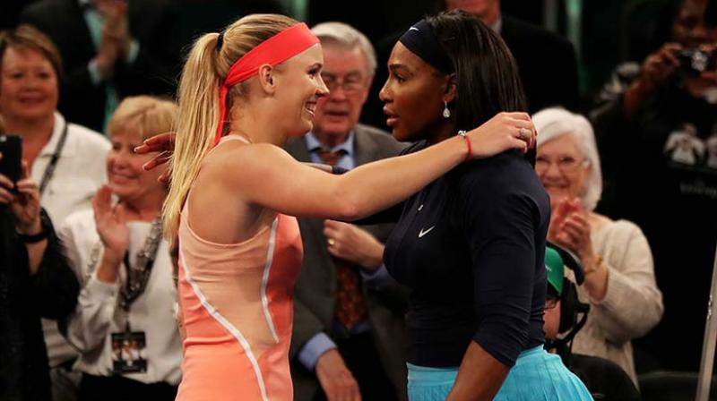 Long-time friends Serena Williams and Caroline Wozniacki will play doubles together for the first time at the WTA Tour's ASB Classic in Auckland beginning on Jan. 6. (Photo:AFP)