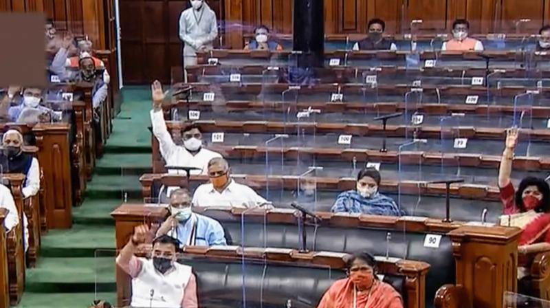 Parliamentarians participate in a debate in the Lok Sabha today. (PTI)