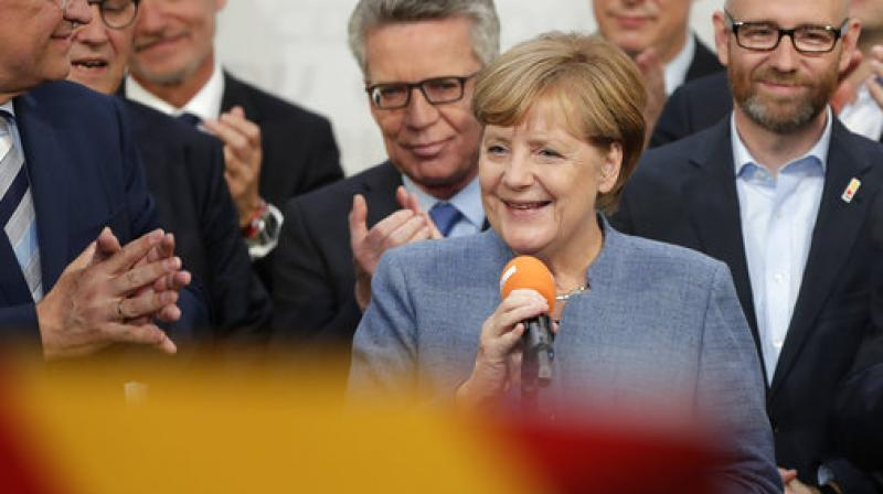 After winning Angela Merkel said 'We will not let one single attack on German democracy stand.' (Photo: AP)