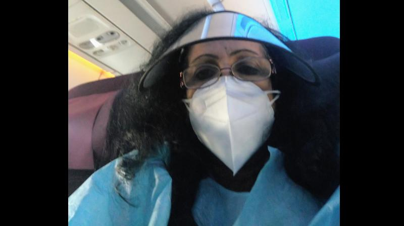 The writer, during one of her flights. (Image by arrangement)