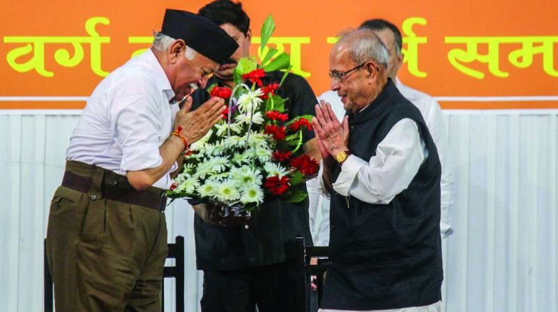"Former President Pranab Mukherjee is welcomed by RSS chief Mohan Bhagwat at the closing ceremony of ""Tritiya Varsha Sangh Shiksha Varg"", an RSS event to mark the conclusion of a three-year training camp for swayamsevaks in Nagpur. (Photo: PTI)"