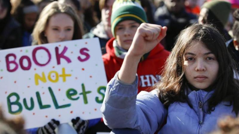 In a historic groundswell of youth activism, hundreds of thousands of teenagers and their supporters rallied across the US against gun violence Saturday, vowing to transform fear and grief into a 'vote-them-out' movement. (Photo: AP)