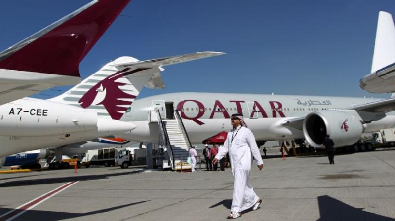 It was not immediately clear if Qatar Airways would also suspend flights to other countries. (Photo: AFP)