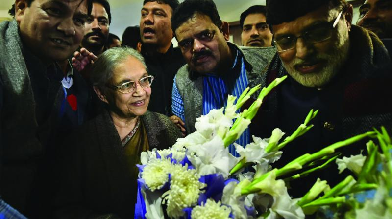 Former Delhi chief minister Sheila Dikshit being greeted with a bouquet at her residence after being appointed as the Delhi Pradesh Congress Committee (DPCC) chief in New Delhi. (Photo: PTI)