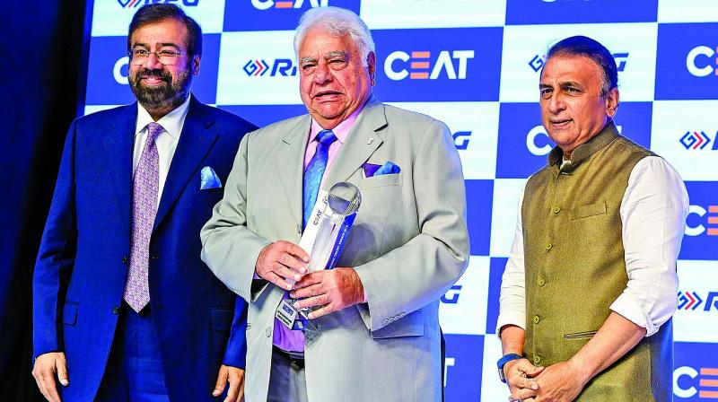 Farokh Engineer receiving the Ceat Lifetime Achievement Award of the Year from Ceat Chairman Harsh Goenka and Sunil Gavaskar last year.