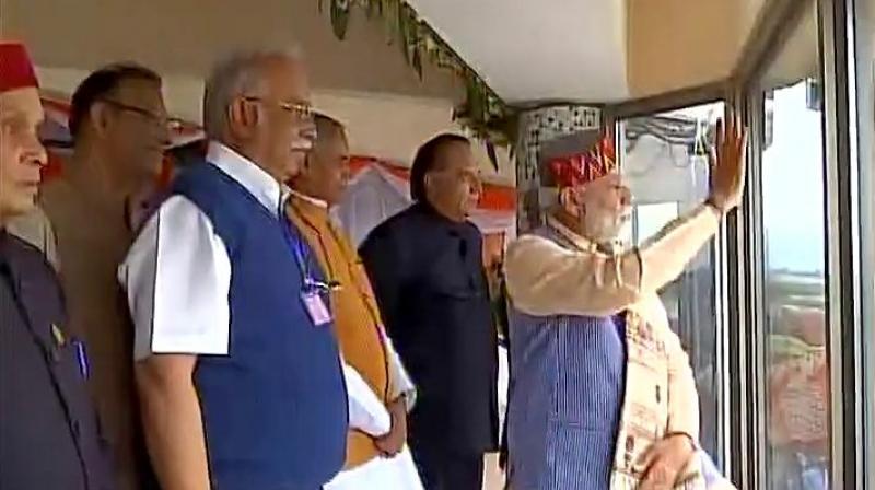 Narendra Modi waves at the first UDAN flight under Regional Connectivity Scheme, on Shimla-Delhi sector. (Photo: Twitter   ANI)