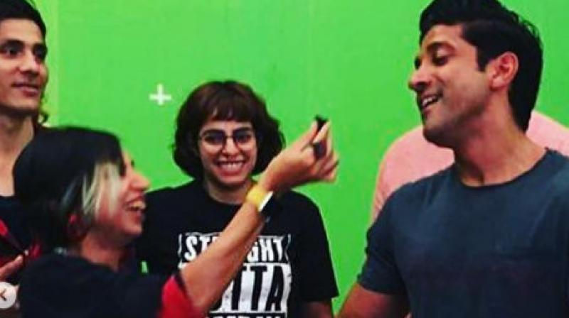 Director Shonali Bose with Farhan Akhtar on the sets of their film 'The Sky Is Pink'. (Image Courtesy: Instagram/ @shonalibose_)