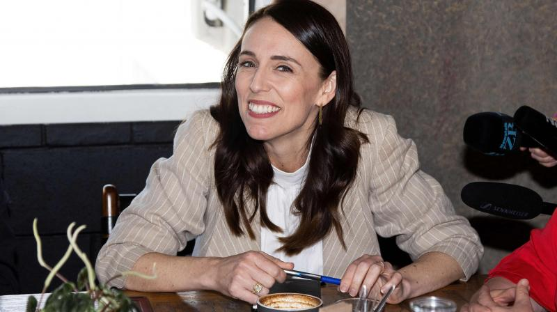 New Zealand Prime Minister Jacinda Ardern speaks with senior members of parliament a day after her landslide election win, in Auckland on October 18, 2020. (AFP)