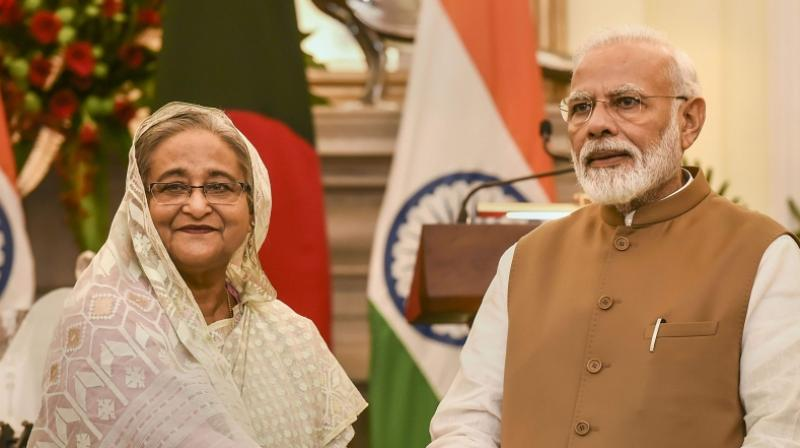 Prime Minister Narendra Modi (Right) with his Bangladeshi counterpart Sheikh Hasina. (PTI)