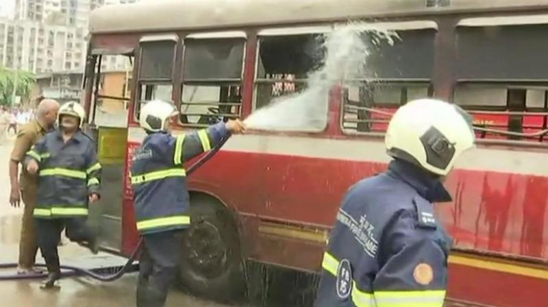 Agitators set a bus ablaze in Mankhurd during the protests. (Photo: Twitter | ANI)