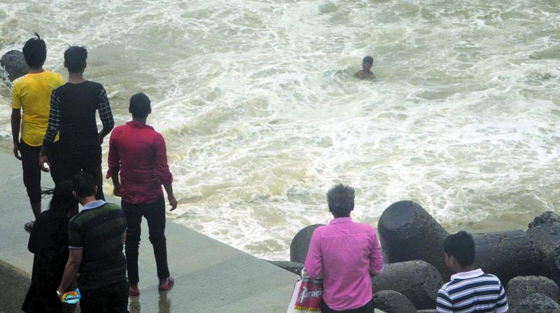 A youngster was drawn into the water while enjoying with his friends at Marine drive promenade during high tide on Saturday afternoon.  Another boy is seen jumping in to save the victim and, unfortunately, drowned too. Onlookers could'nt be of much help due to high tide and gusty winds.  (Photo: RAJESH JADHAV)