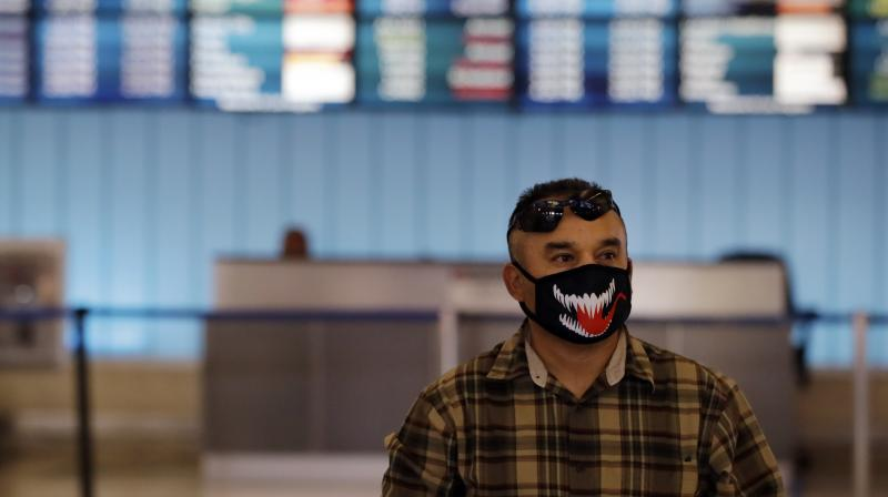 A man arriving from Oaxaca, Mexico, stands near the arrivals gate at the Los Angeles International Airport on Saturday. AP Photo