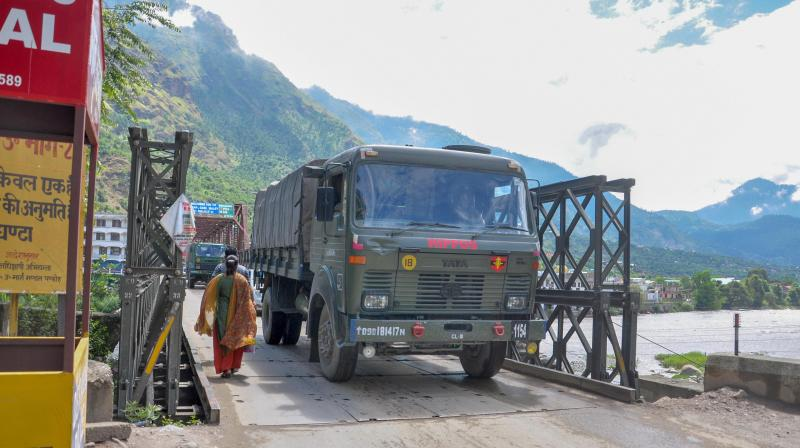 Indian Army trucks move towards Leh via Manali-Leh road, near Manali. PTI Photo