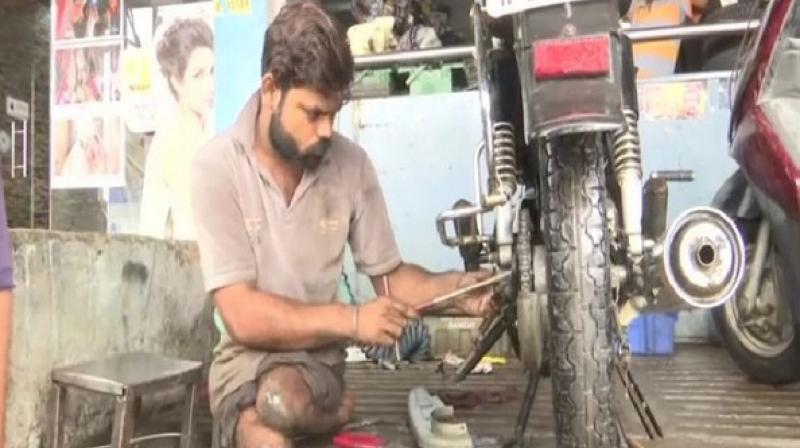 Prajapati who was afflicted with polio at a young age has not let disability hold him back and earns a living employed as an automobile mechanic in a shop. (Photo: ANI)