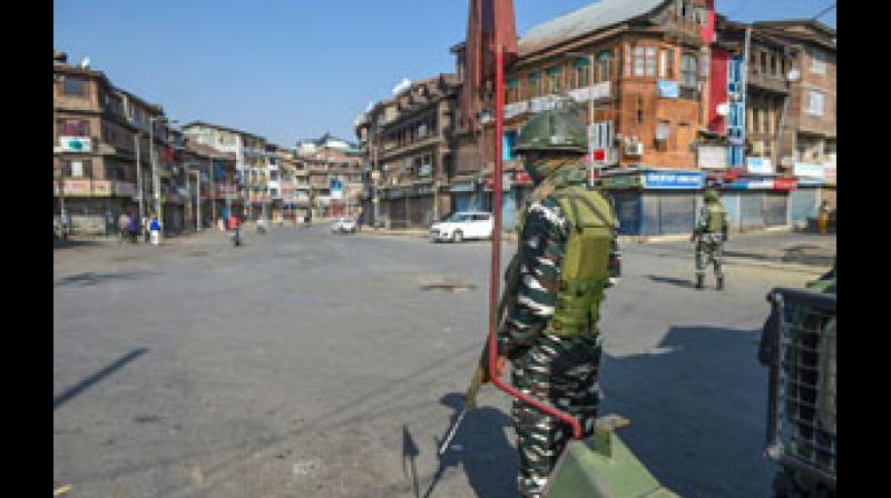 Security personnel stand guard during restrictions in Srinagar on Thursday, following restrictions imposed across the valley as a precautionary measure following the death of pro-Pakistan separatist leader Syed Ali Shah Geelani. —  PTI