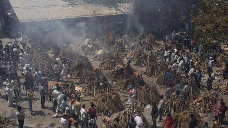 In this April 24, 2021, file photo, multiple funeral pyres of those who died of COVID-19 burn at a ground that has been converted into a crematorium for the mass cremation of coronavirus victims, in New Delhi, India. India's excess deaths during the pandemic could be a staggering 10 times the official COVID-19 toll, likely making it modern India's worst human tragedy, according to the most comprehensive research yet on the ravages of the virus in the country. (AP)