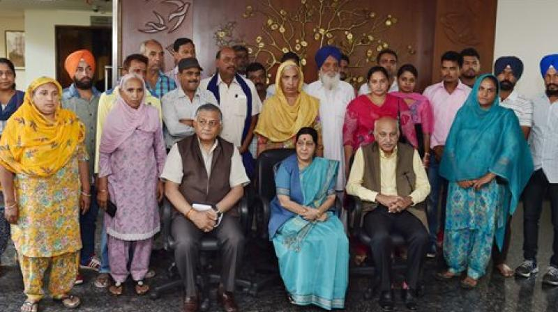 External Affairs Minister Sushma Swaraj with Minister of State for External Affairs M J Akbar and genera V.K. Singh pose for group photo after the meeting with family members of 39 Indian men missing in Iraq since June 2014 in Delhi. (Photo: PTI)