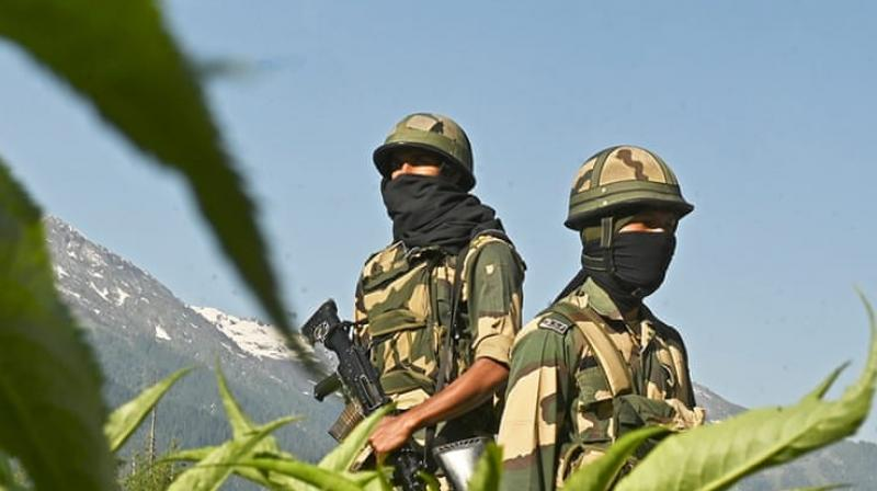 Indian Border Security Force (BSF) soldiers guard a highway leading towards Leh, bordering China, in Gagangir (AFP)