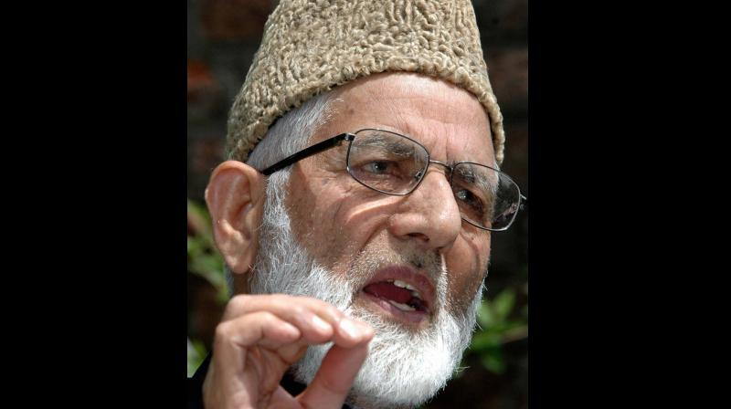 In this file photo dated Thursday, June 12, 2008, of Syed Ali Shah Geelani waves at a crowd, in Srinagar. Geelani, the lifetime chairman of the pro-Pakistan Hurriyat Conference, made a surprise announcement of completely dissociating himself from the 16-party amalgam, alleging lack of accountability and a brewing rebellion in the ranks. PTI Photo