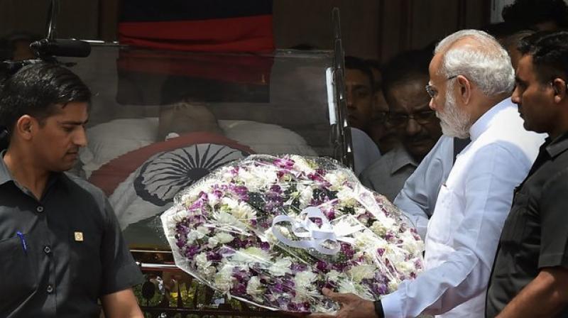Prime Minister Narendra Modi pays his last respects to DMK chief M Karunanidhi at Rajaji Hall, in Chennai. (Photo: PTI)