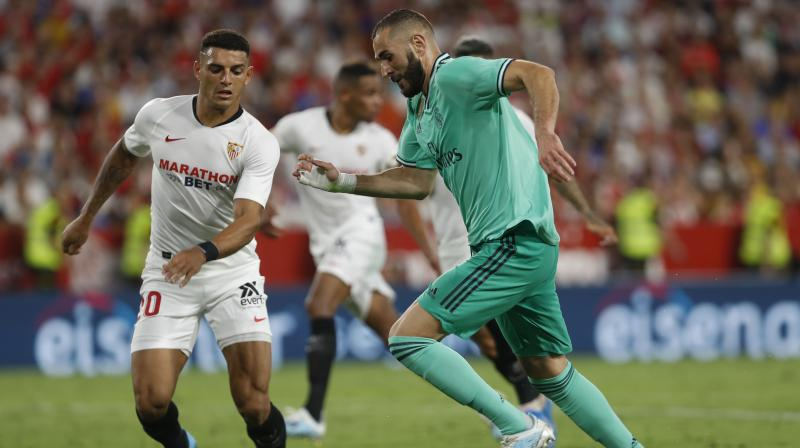 Karim Benzema headed in the decisive goal at the Ramon Sanchez Pizjuan to secure an impressive victory against a Sevilla side that were unbeaten and hoping to return to the top of the table. (Photo:AP)