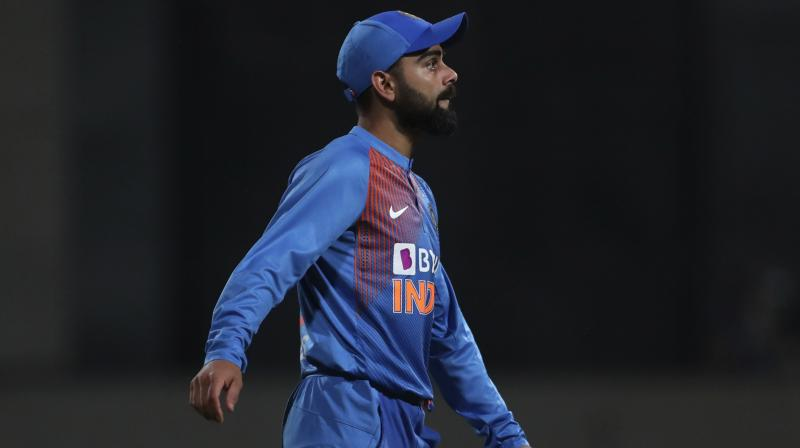 His eyes trained on next year's T20 World Cup, skipper Virat Kohli is willing to take risks in order to mould his India players into an 'unfazed' unit, one that is able to 'take toss out of the equation'. (Photo:AP)