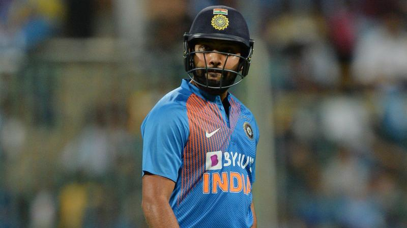 India batsman Rohit Sharma on Sunday equalled Mahendra Singh Dhoni's record of playing in the maximum number of T20 International matches for India during the third T20I game against South Africa at M Chinnaswamy Stadium. (Photo:AFP)